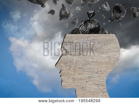 Head as wooden dustbin and falling garbage bags. Garbage and pollution concept. Dramatic and blue sky.