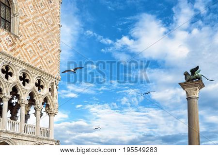 Piazza San Marco or St Mark`s Square in Venice, Italy. Doge's Palace and column with the famous winged lion. It is the main tourist destination in Venice.
