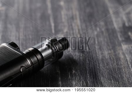 Vaping device on the wooden table