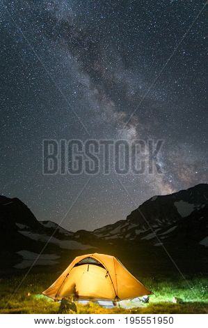 tourist camp in mountain with under starry night sky with  Milky Way