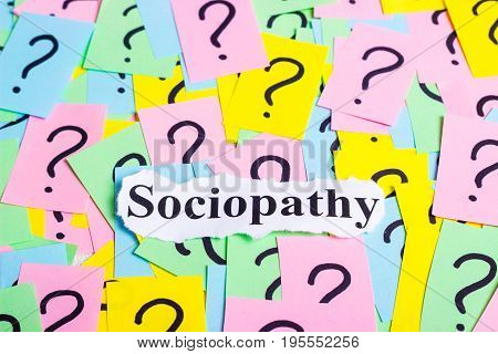 Sociopathy Syndrome text on colorful sticky notes Against the background of question marks