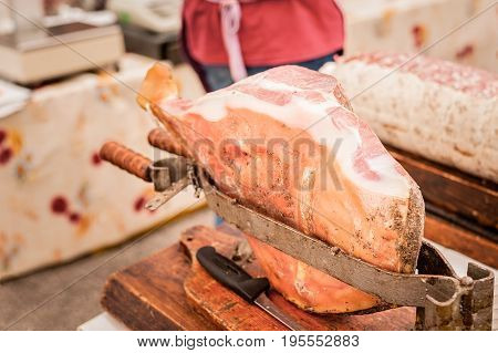Raw ham in the vise ready to be sliced. Typical Italian raw ham.