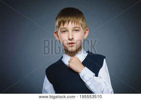 Closeup Portrait of boy going surprise isolated on gray background.