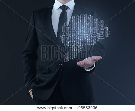 Businessman holding abstract digital human brain hologram on blue background. Future concept