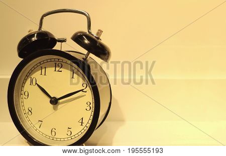 Retro alarm clock in the warm light, with free space for text and design