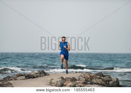 Runner Athlete Boy Jogging Training At Beautiful Beach Of Ocean