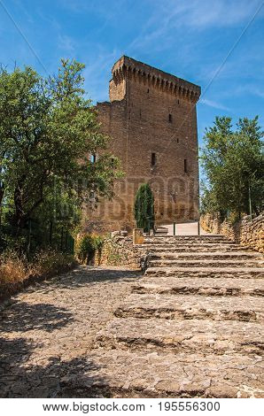 View of staircase to Pope John XXII's Castle in the village of Châteauneuf-du-Pape, blue sky and sunny day. Located in the Vaucluse department, Provence-Alpes-Côte d'Azur region, southeastern France