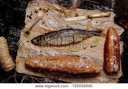 hot smoked herring with rye bread and Bay leaves