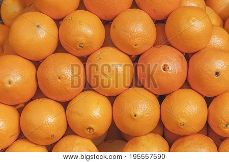 Fresh helathy sweet citrus pile Orange on market ready fot selling