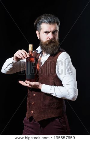 Hipster Holding Bottle Of Red Wine In Hands