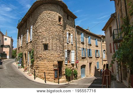 Châteauneuf-du-Pape, France, July 02, 2016. Street view with stone houses in the center of Châteauneuf-du-Pape hamlet, near Avignon. Vaucluse department, Provence region, southeastern France