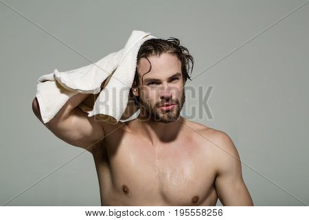Man With Muscular Wet Body Hold Towel In Bath