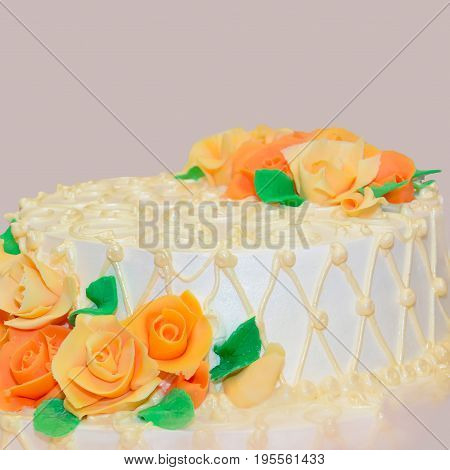 Cake is decorated with rosettes of cream. Sweet festive dessert of the celebrant. Culinary product close.