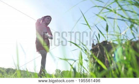 Girl wind nature. girl is standing in the field of green grass. Woman freedom lifestyle