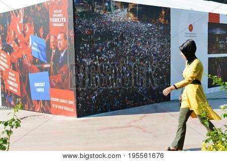 ANKARA, TURKEY - JULY 16: Young girl walks next to information tent to commemorate the one year anniversary of the July 15, 2016, failed coup attempt on July 15, 2017 in Istanbul, Turkey