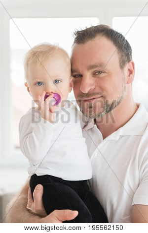 Portrait Of Happy Father And Daughter. Family Values. Leisure Together. Baby Girl With Pacifier In M