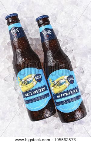 IRVINE CA - JULY 16 2017: Samuel Adams Hefeweizen bottle on ice. From the Boston Beer Company. Based on sales in 2016 it is the second largest craft brewery in the U.S.