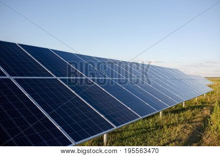 Solar cell panels in the field. Photovoltaic panels installed with helical piles.
