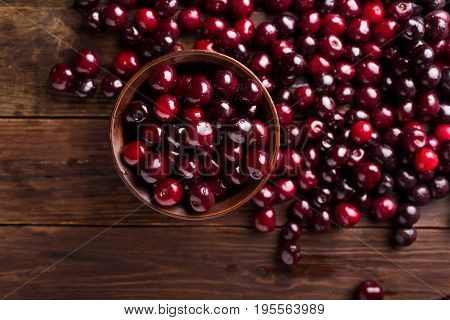 Cherries in a ceramic bowl. Ripe sweet cherry. Cherry. Cherry on a wooden background