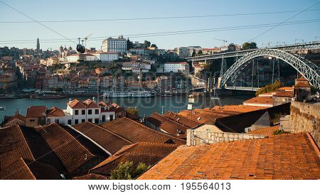View of old downtown, Douro river and Dom Luis I bridge, Porto, Portugal.