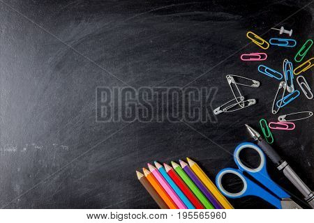 School Supplies Side Border On A Chalkboard Background. School Supplies On Blackboard Background. Ba