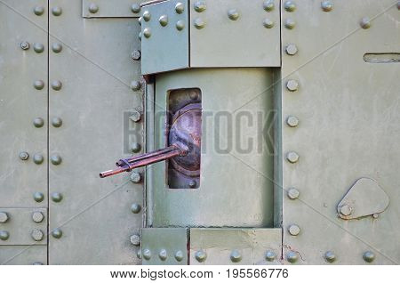 The Texture Of The Wall Of The Tank, Made Of Metal And Reinforced With A Multitude Of Bolts And Rive