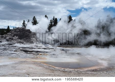 hot steaming geysers in Yellowstone National Park