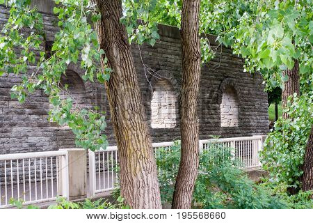 Old Stone ruins with arch three arch windows