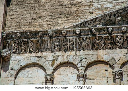 Close-up of decorative capital and frieze on a church in the city center of Nimes. Located in the Gard department, Occitanie region in southern France