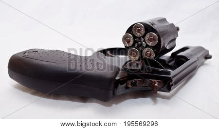 A black, loaded 357 magnum revolver with five bullets