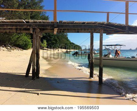Pier on the beach of Doini Island Papua New Guinea.