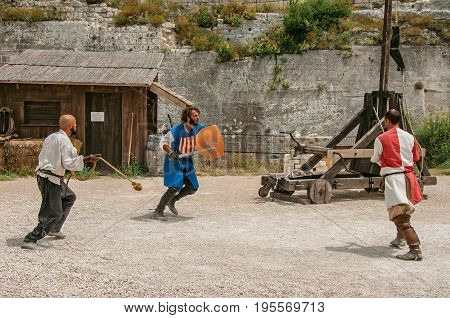 Baux-de-Provence, France - July 05, 2016. Actors doing a theatrical staging as medieval fighters in the castle of Baux-de-Provence. Bouches-du-Rhône department, Provence region, southeastern France