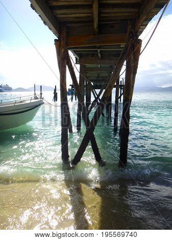 Under The Doini Island Pier At Low Tide, Papua New Guinea.