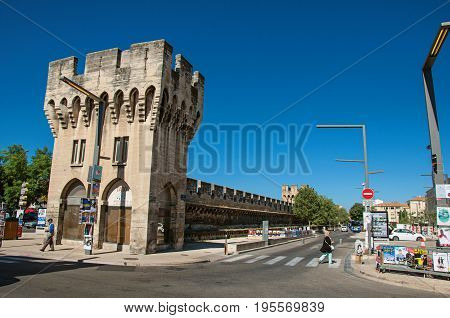 Avignon, France - July 06, 2016. View of one entrance, tower and the wall surrounding the city center of the charming Avignon. Located in the Vaucluse department, Provence region, southeastern France