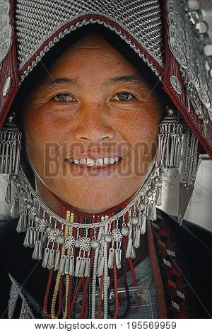 BANGKOK, THAILAND - JANUARY 14 2016: Unidentified hill tribe woman takes part in the celebration of Thai Traditional Culture Festival at Lumpini Park