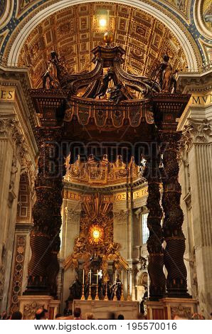 St.Peters,Vatican city,Rome Italy,The worlds largest bronze sculpture is by Bernini and its in St.Peters church in Rome Italy.It sits above the papal altar among the ornate interior.Bring your camera and take life long memories