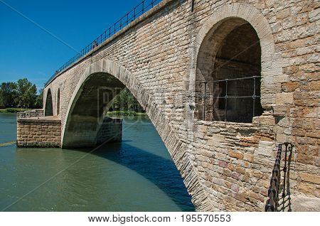 View of the arcs of the Pont d'Avignon (bridge) under a sunny blue sky, city of Avignon. Located in the Vaucluse department, Provence-Alpes-Cote d'Azur region, southeastern France