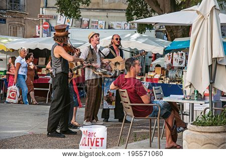 Avignon, France - July 06, 2016. Street performers doing a show to viewer in the city center of the charming Avignon. Located in the Vaucluse department, Provence region, southeastern France