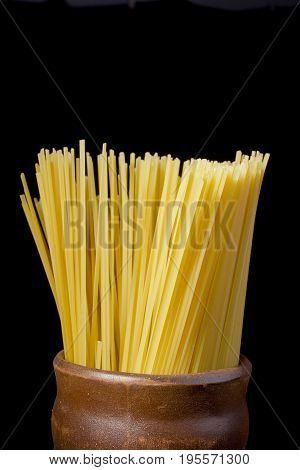 Beam Italian spaghetti in a ceramic pot