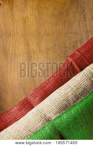 Flag of Hungary on a wooden background of rough fabric.