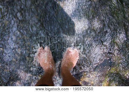 Legs relaxing waterfall plunge whit waterfall happy