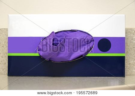 close up on latex glove in paper box in hospital