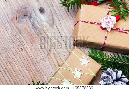 Christmas presents on wooden background retro style with copy space