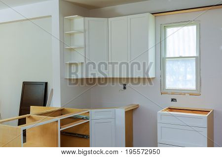 Installation Of Kitchen. The Drawer In Cabinet.
