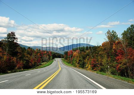 winding high way in Green Mountain area in autumn