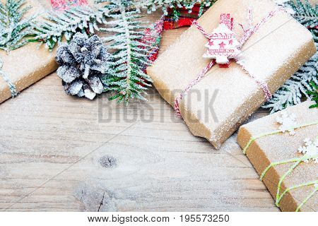 Christmas presents and snow on wooden background retro style with copy space
