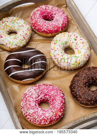 Colorful donuts with chocolate and icing selective focus