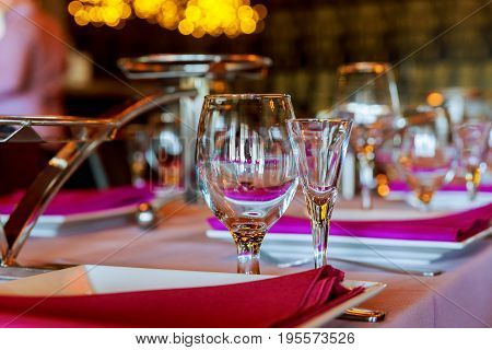 Served For A Banquet Catering Table With Wine Glasses And Plates