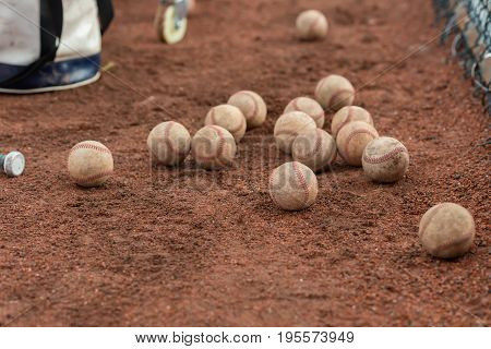 dozens of baseballs on field horizontal composition