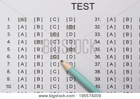 test score sheet with answers and pencil close up